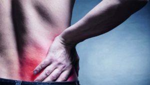 Болит низ спины: причины и лечение